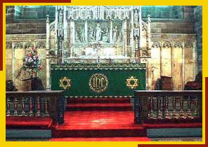 High Altar with reredos which depicts Christ feeding the 5000